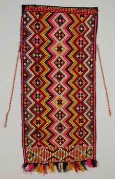 It is made of black tabby woven cloth. Small, regularly spaced diamond motifs have been inserted using discontinuous supplementary weft. Greek Traditional Dress, Greek Costumes, Zigzag Line, Bulgarian, British Museum, Red And White, Black, Wool Yarn, Bohemian Rug