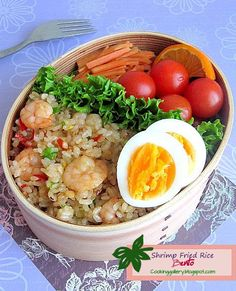 A very simple but delicious bento today: spicy shrimp fried rice served with slices of hard-boiled egg, cherry tomatoes and pickled carrot salad.