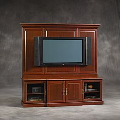 @Overstock - The Sauder Entertainment Wall features two framed glass doors for your components and two framed solid doors for your media. With a TV mounted on the back wall, this entertainment center will be a great addition to any decor.  http://www.overstock.com/Home-Garden/Sauder-Cherry-Entertainment-Wall/5977910/product.html?CID=214117 $408.99