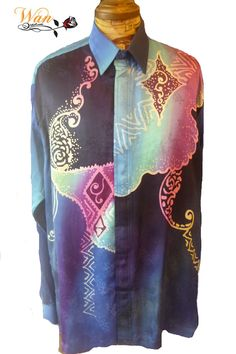 Batik Shirt Hand Drawn in Jacquard Silk 100%. Suitable for  casual wear and for the evening wear. Available in multi colours with different batik motifs.  All Stores and boutique enquiries are welcome. Kindly visit our website at: www.wanrosnah.com