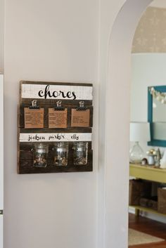 Not as a chore chart, but like the wood with clips and jars for kitchen wall organization