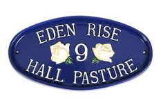 The sophisticated elegance of this deep blue house sign is evident with the cream roses set off beautifully. Eden Rise is an apt name for such a beauty.