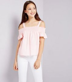 Teens. Gear up for summer in this cute cold shoulder top. Pair with skinny jeans and trainers for a casual look. - Bardot neckline - Cold shoulders - Shirred detail - Simple short sleeves - Soft cotton blend - Casual fit that is true to size