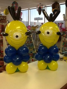 Despicable me balloon table decorations. Made by Let's Celebrate Parties