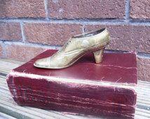 Cendrier de Brass vintage de chaussure.
