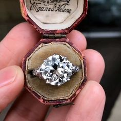 A stunning antique, Art Deco round diamond engagement ring in a crown setting with small diamond side stones. Small Engagement Rings, Deco Engagement Ring, Round Diamond Engagement Rings, Art Deco, Ring Verlobung, Belle Epoque, Beautiful Rings, Diamond Are A Girls Best Friend, Round Diamonds