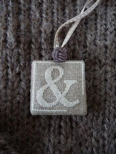 cross stitch book marker tag or maybe a necklace