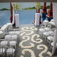 A modern white wedding over an infinity pool in Costa Rica. Love this event!