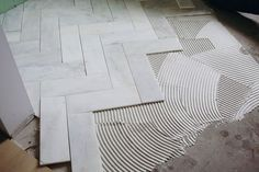 4x12 tile cut from 12x12 tile and laid in herringbone pattern.  we may need a smaller size tile to get the full effect on our fllor