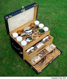 Really cool well equipped vintage Louis Vuitton picnic set for A modern set like this for 4 would be an awesome find but it seems that new picnic sets are cheesy plastic. Too bad things aren't made the way they used to be.