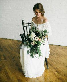 Beautiful boho bride, dress, and bouquet