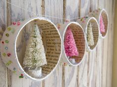 bottle-brush ornaments in pink & green inside a circle garland @Janie Cooper