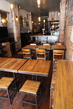 Bar, stools, tables and chairs furnishing this restaurant are made of reclaimed bowling alley wood.