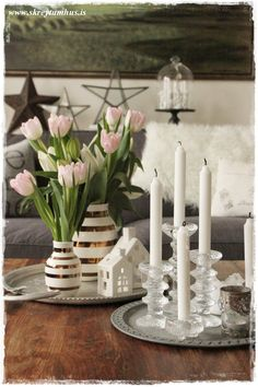 look at round trays (I have 2 bigger Ikea trays)  with the glass candlesticks and tapers...love, love...