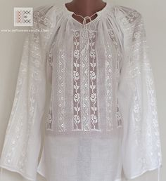 Ajur - is the Romanian name for this type of embroidery based on the separation of the threads of the textile cloth. Very delicate embroidered Romanian blouse.
