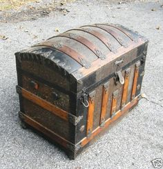 my mum's old camel back steamer trunk looks almost exactly like this one.