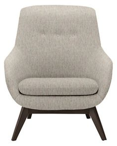 A mid-size accent chair that takes lounging to a new level, our Henrick chair features a soft, organic shape and a solid wood base that will make you take notice. Details like a button-tufted back and precise seaming give Henrick timeless appeal.