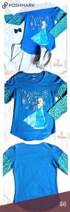 "Frozen Elsa Girls Long Sleeve Tee Size 10. Frozen Elsa Girls Long Sleeve Tee Size 10. Blue tee with princess Elsa on the front and snowflakes print on sleeves. Approximately 20"" length, and 13"" width (under armpit). 100% cotton. Disney Shirts & Tops Tees - Long Sleeve"