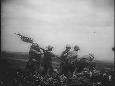 Marines raising the flag atop Mount Suribachi during the battle for Iwo Jima, February 23, 1945.