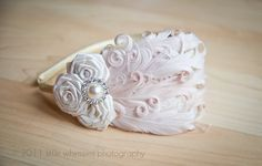 Ivory feather and satin rose headband:  Weddings,  Flower girls, Communions, Baptisms- Newborns, Infants, Toddlers, Girls. $20.99, via Etsy.