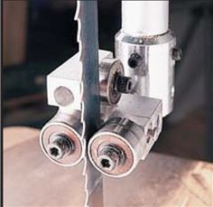 Bandsaw Resawing - Popular Woodworking Magazine - 9. Guide bearings instead of guide blocks (shown here without the guard) can help bandsaw blades run straighter.They cost about $150, and are available for virtually any saw