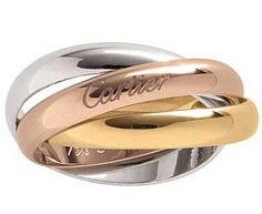 Cartier trinity wedding bands ♥ totally my fave.. Combination of white, yellow, & rose gold.. Consists the meaning of friendship, fidelity, & love..
