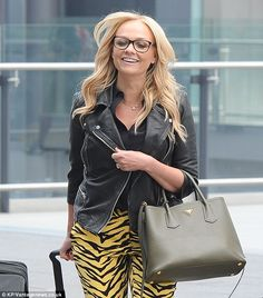 Time to party: Emma added a leather jacket and geek chic glasses to her travel look...