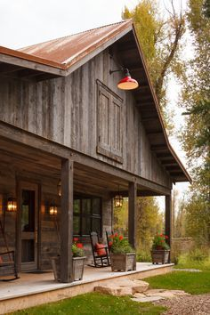pole barn houses in Exterior Rustic with corrugated metal roof accessory building