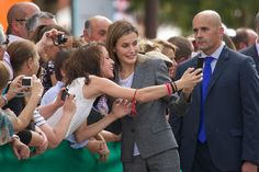 Letizia looked happy to pose for a selfie with a fan in Zafra, Spain, in October 2014.