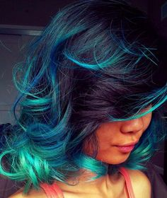 Colour. Bright blue color on ends. Tips of hair. Curly hair. Hairstyle curly. Shoulder length medium hair. Dyed.