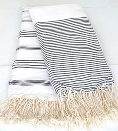 Turkish towels! Absorbent woven cotton or linen gets softer the more you use it, doesn't pick up unwanted sand, minimizes frizzy hair, rolls into a small bundle for easy packing, and doubles as a wrap, blanket or tablecloth.