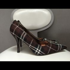 Brown plaid pumps Accent a plain outfit with these awesome pumps! Brown plaid fabric upper & brown patent leather heels. Never worn. Size 8. Charlotte Russe Shoes Heels