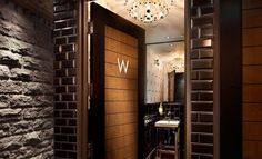 Bathroom , Some References of Luxury Restrooms for Male or Female in Any Public Places : Inspiring Images for Creating Own Home Restrooms : Cool Restroom With Excellent Interiors : Hardwood Door, Brick Walls And Amazing Pendant Lights