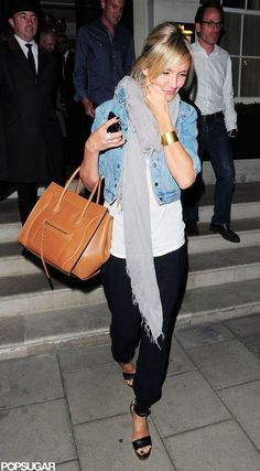Cameron Diaz in a denim jacket, black strappy heels, Celine bag, gold cuff. Simple and just right.