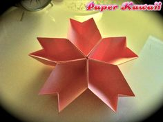 cherry-blossom-sakura-box-origami-dish Increase the number of petals (modules) using shiny paper and it makes a beautiful ornament, I used a dollar store gift bag. Origami Box, Paper Crafts Origami, Origami Flowers, Oragami, Dollar Store Gifts, Paper Christmas Ornaments, Anime Crafts, Cherry Blossom, Diy And Crafts