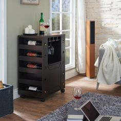Simply enjoy a night with friends over a great conversation and wine with this stylish wine rack buffet table. The Kerstin buffet features plenty of storage along the sides for wine bottles and a spacious cabinet for storage of your wine glasses and other dinnnerware. The caster wheels make... more details available at https://furniture.bestselleroutlets.com/game-recreation-room-furniture/home-bar-furniture/bar-wine-cabinets/bar-cabinets/product-review-for-furniture-of-americ
