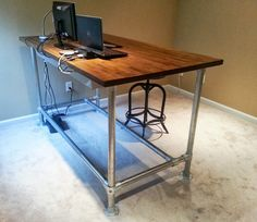 Jeff used a fairly straight forward design for the desk, including an extra bar at the bottom of the desk to put his feet on while sitting or standing. He was able to order pipe so that the desk would fit his working height perfectly.
