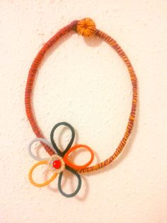 Wool necklace with colourful flower. Entirely hand by Theart2