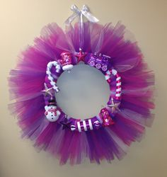 Tulle wreath for Christmas so easy & so cheap. Just get foam round door hanger and tie the tulle in about 15 in strips around!