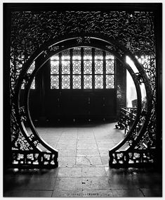 Moon Gate by Joseph Qiu on 500px.  A Moon Gate is a circular opening in a garden wall that acts as a pedestrian passageway, and a traditional architectural element in Chinese gardens. Sometimes wooden Moon Gate can also be found in luxury residential homes, decorated with beautiful carvings.