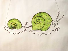 Little Snails Mother and baby snail wire sculpture with green recycled paper stretched on the shell
