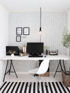 Great, clean office space. Love the b/w rug!!