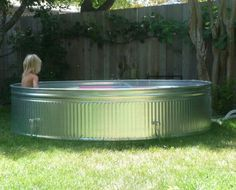 """Another one for the """"worth the effort"""" DIY files... Cathy and her husband wanted a chlorine-free pool big enough for the whole family to splash around in during the hot Santa Rosa summer. Hoping for something more attractive than a big vinyl tub, they finally decided on a galvanized steel stock tank. All it took was some clever DIY plumbing, and for about $500 they were living the good life. Learn how they did it after the jump..."""