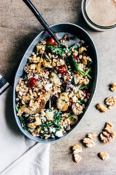 Eggplant and Caramelized Onion Grain Salad with Walnut Vinaigrette  Serves 4 as a side  | Ingredients |  1 small eggplant, cubed 1 tbsp. olive oil 1 small yellow onion, thinly sliced 1 cup pearled farro 2 cups spinach, loosely packed 1 cup red grapes, halved 1/2 cup feta cheese salt and pepper  For the dressing:  1/4 cup walnuts 1/3 cup olive oil 2 tbsp. white wine vinegar 2 tsp. honey 1 tsp. dijon mustard salt, to taste