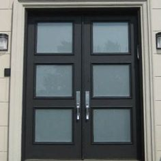 Black front door with frosted glass