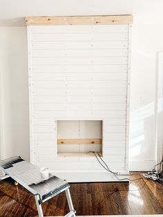 Step by step tutorial on how to build an inexpensive shiplap fireplace using an electric insert. Transform your boring TV wall into a statement piece. Wall Units With Fireplace, Wood Mantle Fireplace, Build A Fireplace, Fireplace Built Ins, Home Fireplace, Fireplace Ideas, Rustic Fireplace Decor, Farmhouse Fireplace, Recessed Electric Fireplace