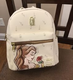 From Beauty and the Beast, Belle is surrounded by falling roses. Measures 9 x 4 x 10 Cute Mini Backpacks, Trendy Backpacks, Girl Backpacks, Disney Handbags, Disney Purse, Cute Disney Outfits, Fashion Bags, Fashion Backpack, Backpack Purse