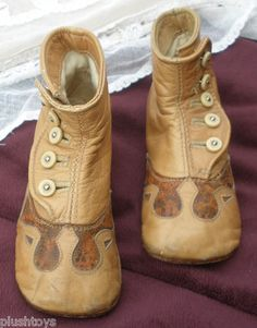 ANTIQUE TAN FANCY LEATHER HIGH TOP BUTTON BABY BOOTS.