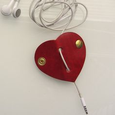 Leather earbud / earphone / headphone cable organizer in red vegetable tanned leather. Personalizing