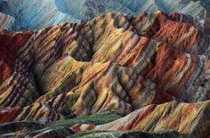 The Rainbow Mountains (a.k.a The Gansu Zhangye National Geopark) is located in northern  China. this is a unique site with an amazing landscape configuration, The Geopark has been recognized as a UNESCO World Heritage Site.